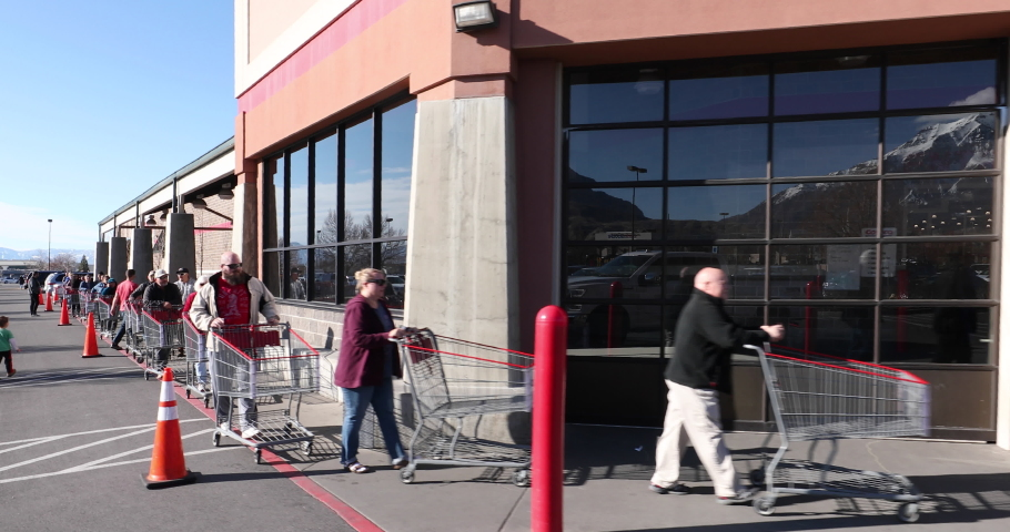 Circa - 03/17/2020 - Orem, Utah - Long line out side grocery store during pandemic for Coronavirus.