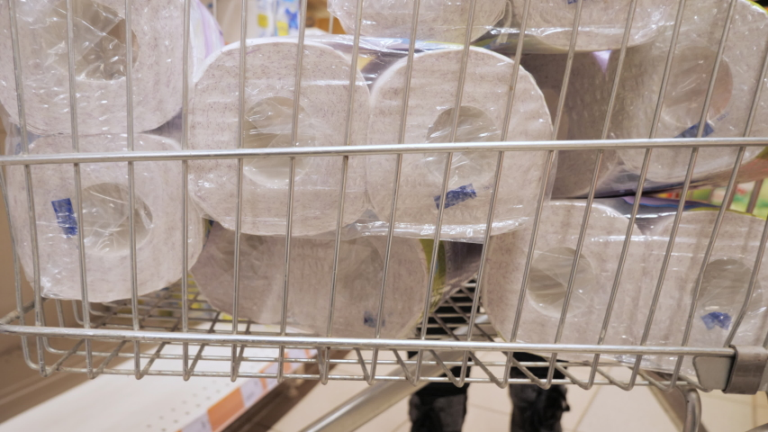 Coronavirus quarantine shopping. Preparing and stock up for coronavirus quarantined at home during the coronavirus pandemic. Panic. Deficit. Buying toilet paper. Local residents shop at a supermarket. #1048571128