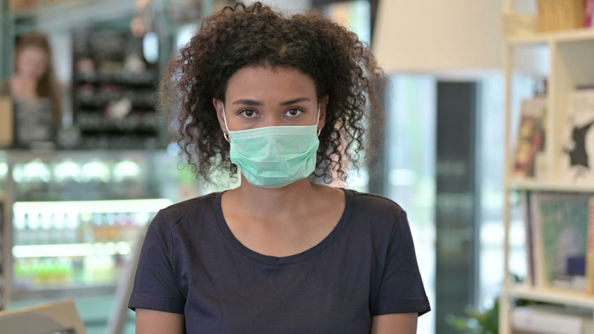 Portrait of Young African Woman with Face Mask    Shutterstock HD Video #1048577317