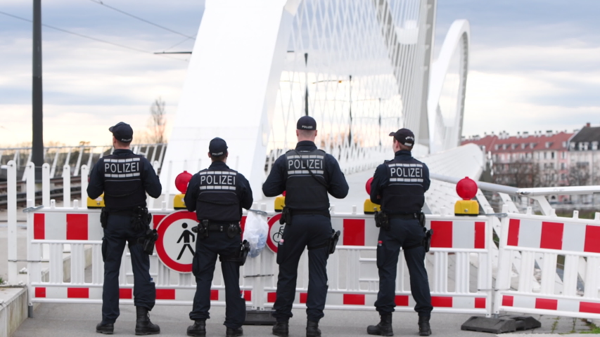 Kehl, Germany - Mar 16, 2020: German Polizei Police officers checks traffic at the border crossing in Kehl from France Strasbourg during crisis measures in the fight against coronavirus
