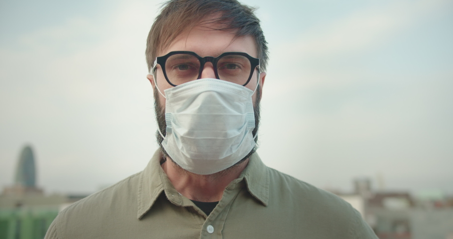 Happy positive cured pandemic man takes off his medical mask of coronavirus protection outside.Concept of healthcare and safety life,COVID19 coronavirus,healing virus,stop pandemia in World | Shutterstock HD Video #1048603441