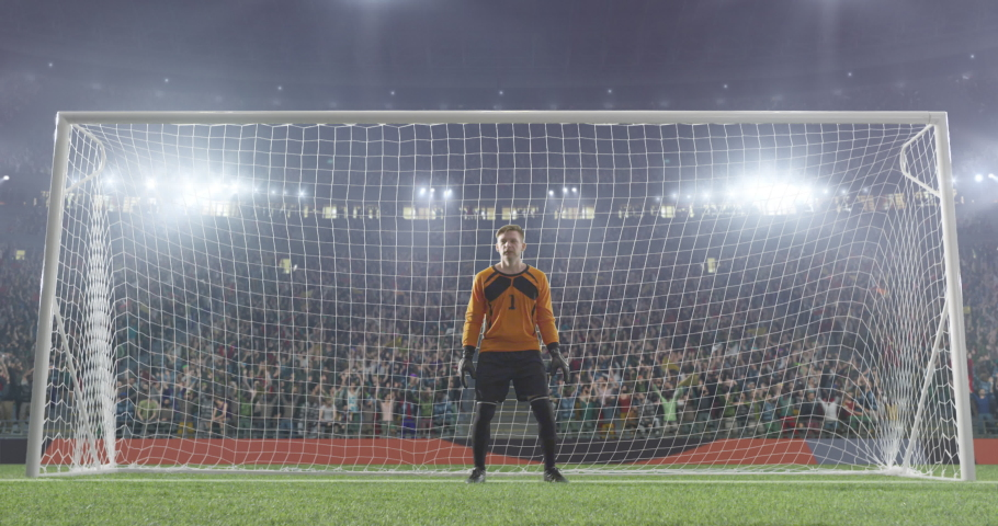 Soccer goalkeeper jumps and fails to catch ball on a professional soccer stadium. Mask of the foreground added in the end of the video.  Stadium and crowd is made in 3D and animated