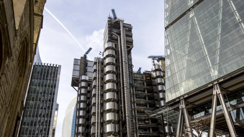 Hyperlapse of London's Lloyds Building in the day. Camera tracks in to a very dynamic angle. | Shutterstock HD Video #1048626655