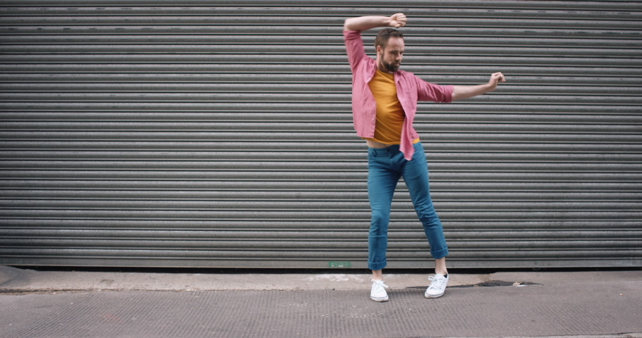 Dance loop funny man dancing in street having fun celebrating with funky looping dance 4k | Shutterstock HD Video #1048631479