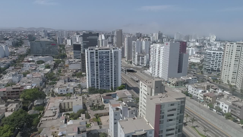 Miraflores district, in Lima Peru. During the lockdown for coronavirus. Empty streets, few public transportation. Aerial view. Some cars and buses in one of the more transit avenues in Lima.