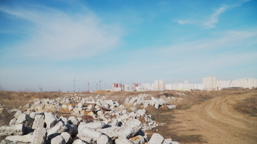 Pollution concept. Garbage pile in trash dump or landfill. Global damage environmental. Construction debris. Slow motion. Shooting on the Steadicam. | Shutterstock HD Video #1048648483