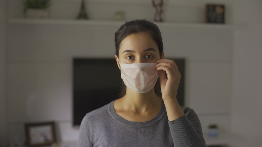Portrait of a young student woman wearing protective mask on street.Concept of health and safety life, N1H1 coronavirus, virus protection, pandemic  | Shutterstock HD Video #1048649206