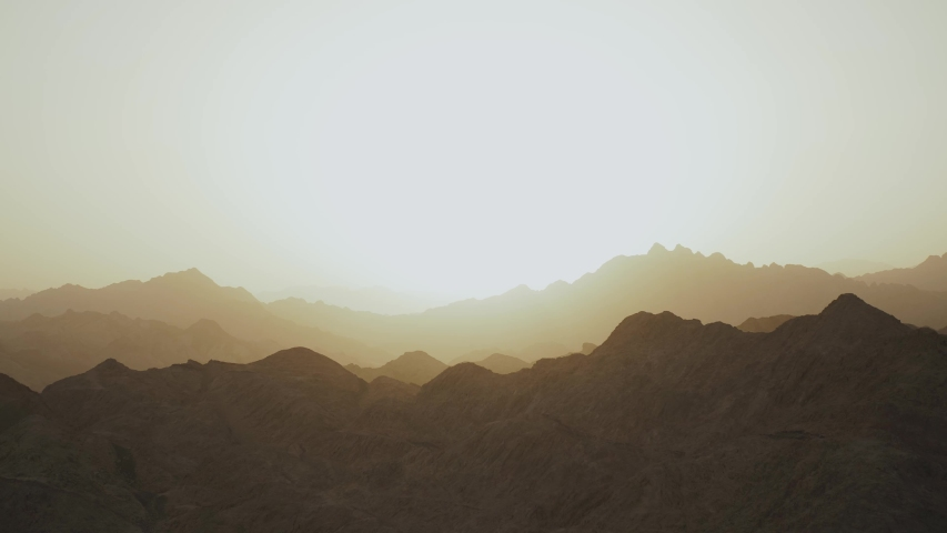Amazing sunset at Egypt Sinai mountains, Sinai desert, mountains peaks, silhouette of mountains, flat, slow motion, 4k