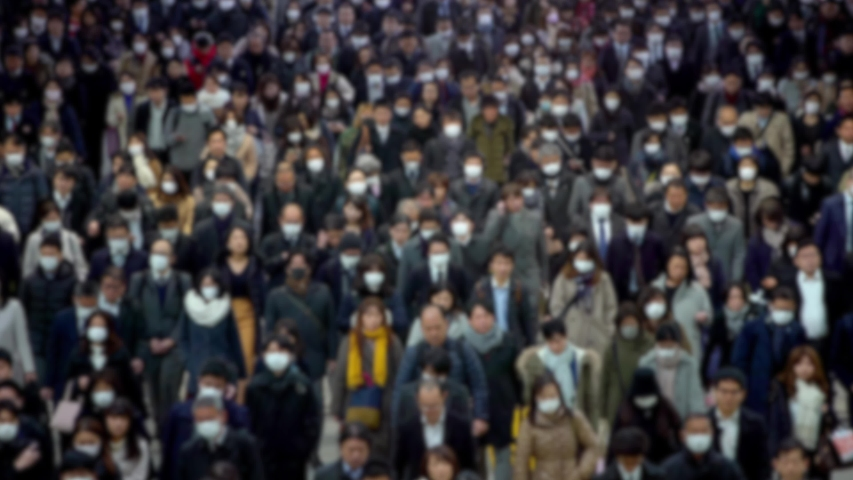 4K, Blurred defocused view of Concept of coronavirus quarantine, MERS-Cov. Large crowd of business people with medical face mask. Air pollution. The virus has caused emergency situation.-Dan