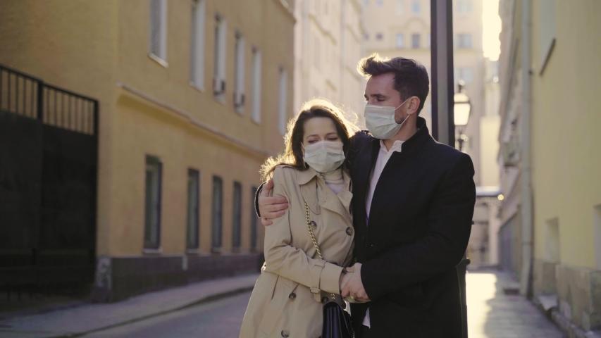 Sad Masked Man and Woman Walk Down the Street at quarantine | Shutterstock HD Video #1048699519