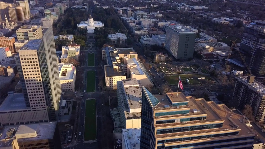 Aerial View Of Capitol Mall, Capitol Building, Government Buildings, Downtown, Capitol Park with US Flag in foreground