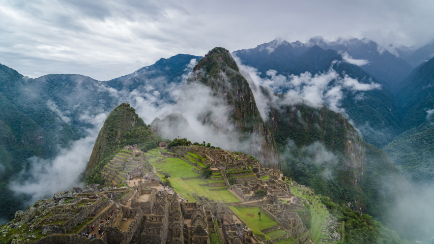 Time lapse view of mysterious Machu Picchu Inca ruins shrouded in mist high in the Andes mountains, Cusco Region, Peru.