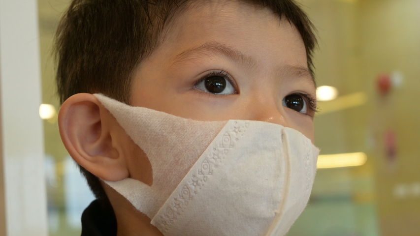 Asian child boy wearing hygienic protective mask protect disease virus covid-19 epidemic | Shutterstock HD Video #1048725418