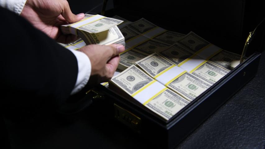 Stacks of 100 dollar bills in a briefcase , briefcase full of money .