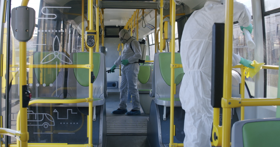 HazMat team in protective suits decontaminating public transport, bus interior during virus outbreak Royalty-Free Stock Footage #1048741780