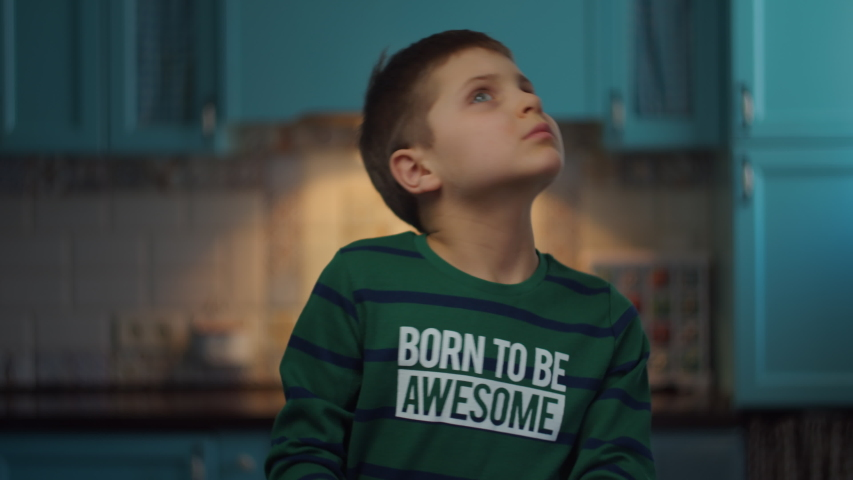 Autistic boy gesticulating with hands standing at the kitchen in slow motion. Happy child with autism at home. Autism awareness Royalty-Free Stock Footage #1048742713