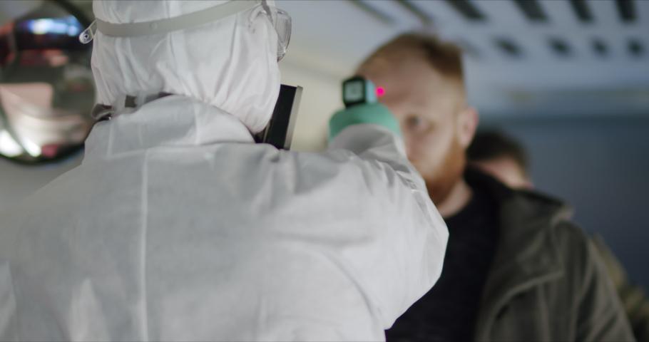 HazMat team in protective suits decontaminating public transport tourist bus interior during virus outbreak. Coronavirus, COVID-19 Royalty-Free Stock Footage #1048763113