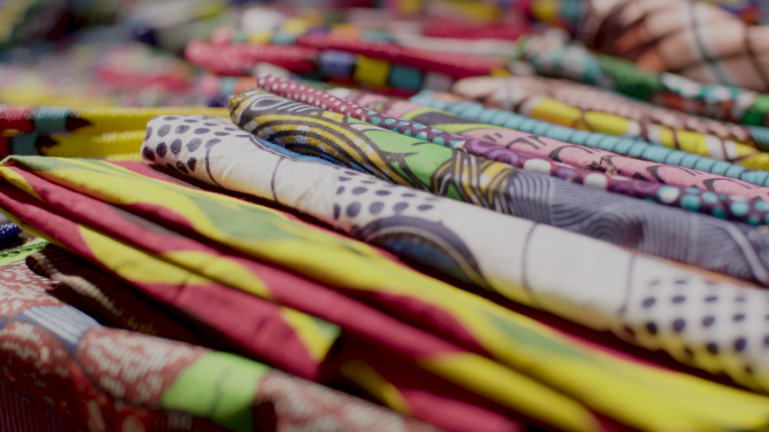 A close up shot of the colourful, traditional African fabric for sale at a crafts market in the Maboneng district of Johannesburg, South Africa.  Royalty-Free Stock Footage #1048800226