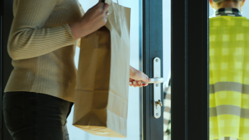 The courier delivers food home. Delivery of food in quarantine Royalty-Free Stock Footage #1048807021