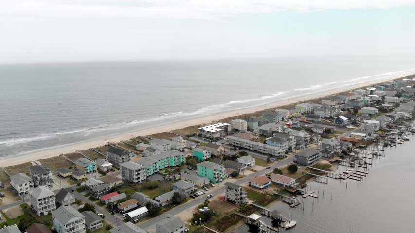 Aerial footage of Carolina Beach NC ocean waves, sand, and houses