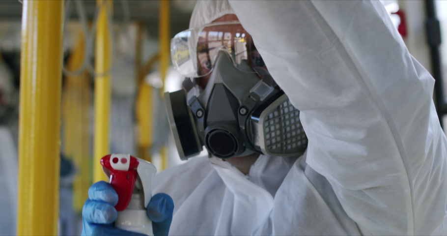 HazMat team in protective suits decontaminating public transport, bus interior during virus outbreak , coronavirus, COVID-19 Royalty-Free Stock Footage #1048813867