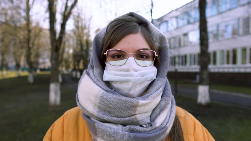 Portrait of a young student woman wearing protective mask on street. Concept of health and safety life, N1H1 coronavirus, covid-19, virus protection, pandemic in china | Shutterstock HD Video #1048828765