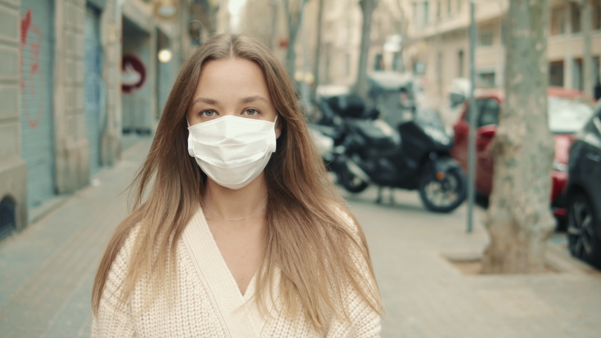 Virus mask spanish woman on street wearing face protection in prevention for coronavirus covid 19. Lady walking in public space on quarantine for food | Shutterstock HD Video #1048830811