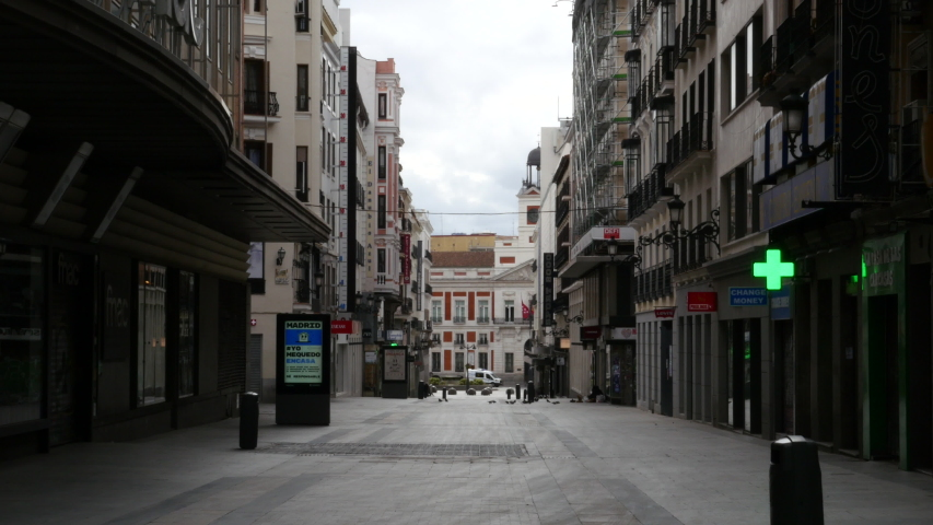 Preciados street in Madrid without people due to the state of alert in Spain by COVID-19. Filmed on March 23, 2020.