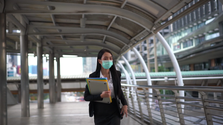 Slow Motion Asian woman are going to work.she wears   .Prevent PM2.5 dust and smog | Shutterstock HD Video #1048849771