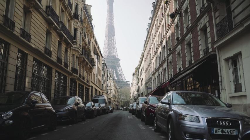 Paris, France - 03 20 2020: Empty street near Eiffel tower in Paris france, during coronavirus / covid-19 lockdown