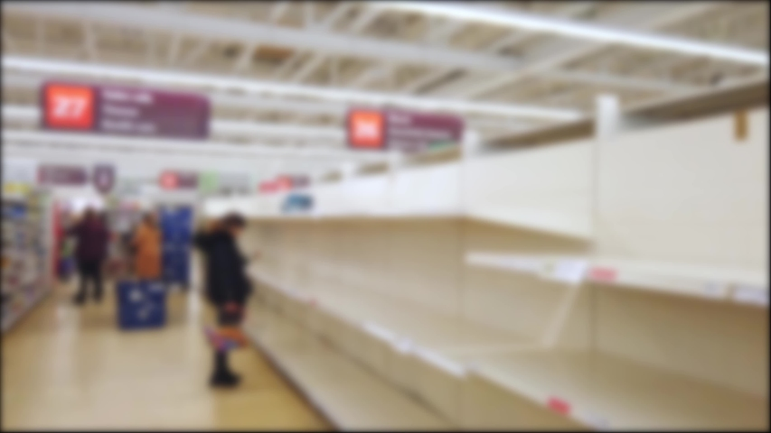 Blurred empty supermarket toilet rolls shelves as a result of Covid-19, Coronavirus, pandemic induced panic buying | Shutterstock HD Video #1048906681