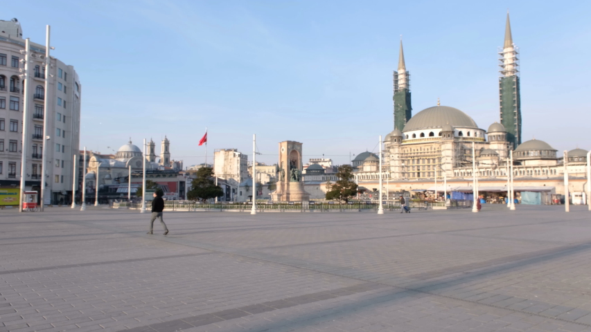 Taksim square, usually thronged with people, is seen mostly empty after Turkish gorverment has called upon the public to stay at home. | Shutterstock HD Video #1048908649
