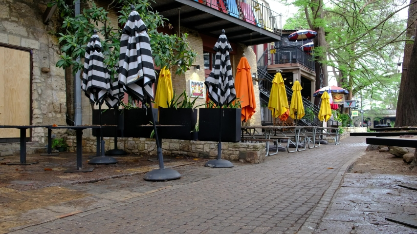 SAN ANTONIO, TEXAS - 03/23/2020 - Closed patio and restaurants in San Antonio downtown during corona virus outbreak. City council closed down bars and restaurants in attempts to contain the outbreak