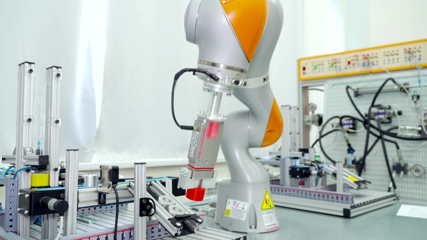 Modern automated hand in enterprise. Scene. Automated robot arm for rearranging finished parts in modern factory. Modern robot technology in work at enterprise | Shutterstock HD Video #1048966225