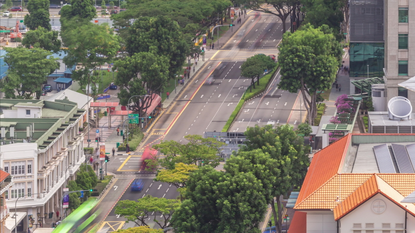 Traffic with cars on a street and urban scene in the central district of Singapore aerial timelapse. Hill street intersection. Green trees around | Shutterstock HD Video #1048970002