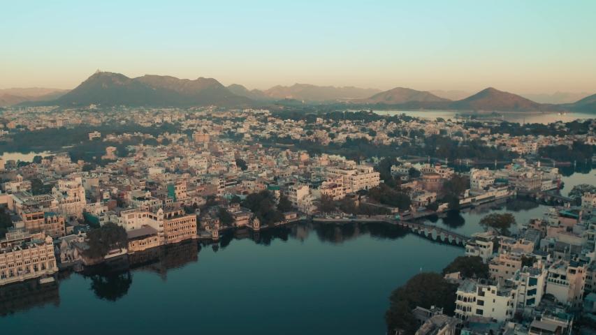 Beautiful ariel city view from lake Pichola, Udaipur (City of lakes) Rajasthan, India, 4k Drone shot.