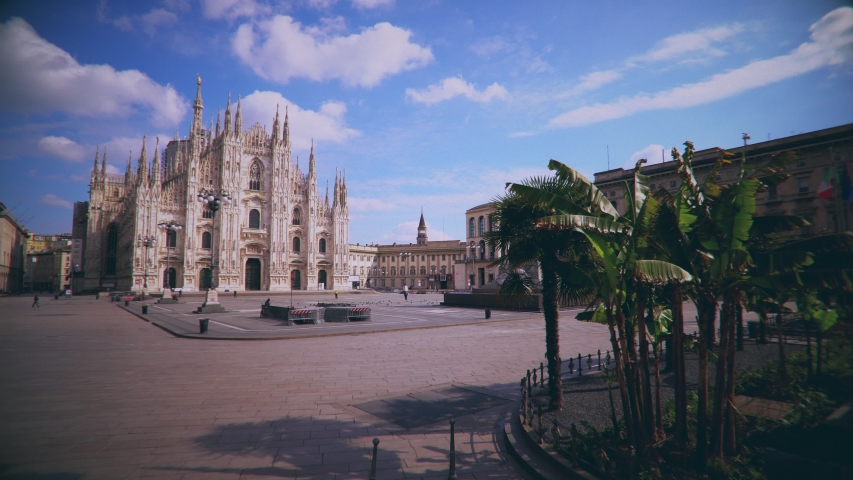 Milan, Italy - March 17, 2020: empty square in front of the cathedral. Chinese Covid Crown Virus 19. Quarantine. Pandemic. City of the desert. Piazza Duomo Empty streets.  | Shutterstock HD Video #1049016148