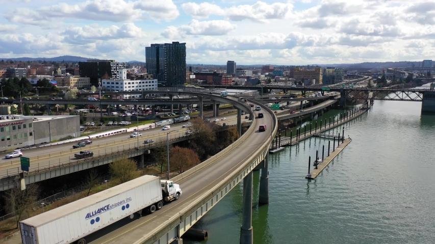 CIRCA 2010s - High angle aerial shot of freeway traffic Amtrak train and Willamette River in Portland, Oregon.