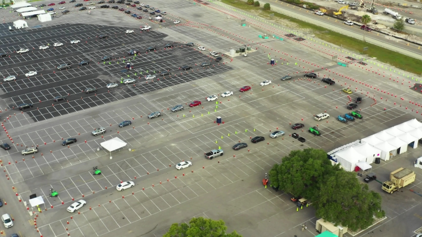 Cars moving in line for Coronavirus Covid 19 testing Miami | Shutterstock HD Video #1049029783