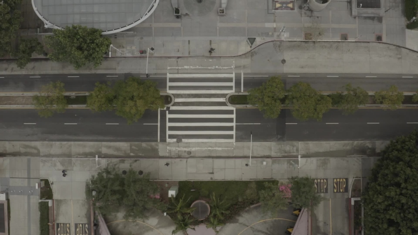 CIRCA 2020 - aerial top down of empty abandoned streets of Los Angeles during corona virus outbreak epidemic.