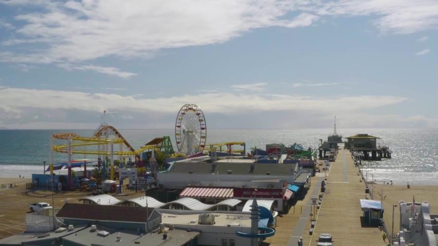 CIRCA 2020 - aerial of abandoned closed Santa Monica pier during Covid-19 corona virus outbreak epidemic.