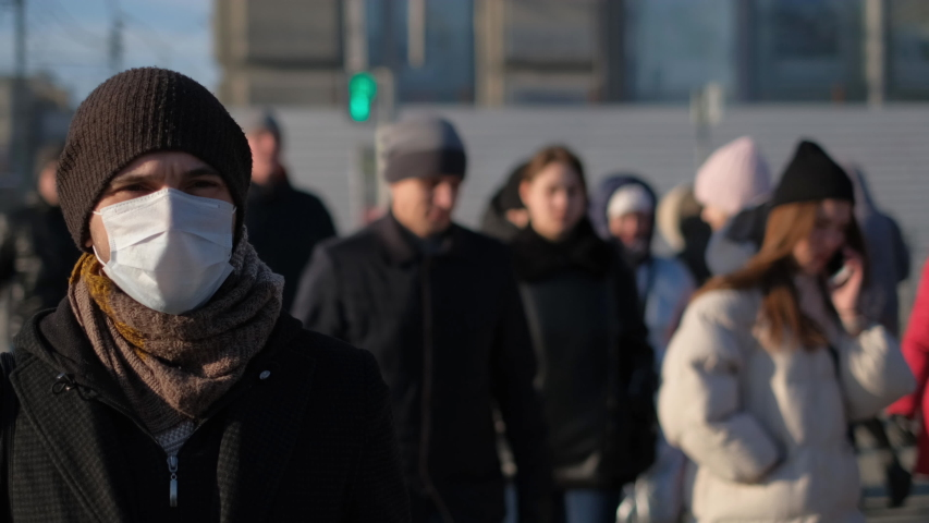 Europe infected corona virus 2019 ncov. European man 4k. Face mask for covid-19. City street. Epidemic coronavirus. Pandemic flu corona virus. Human masked for 2019-ncov. Crowd people sick covid-19. | Shutterstock HD Video #1049039362