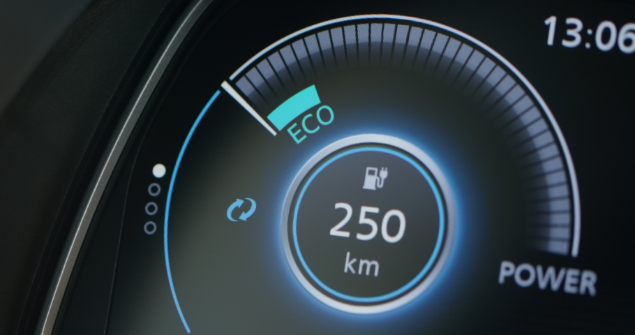 Electric car dashboard display closeup. Electric Car Concept. Battery indicator showing an increasing battery charge. The battery indicator shows it fills up to 100. Electric Car Battery Gauge