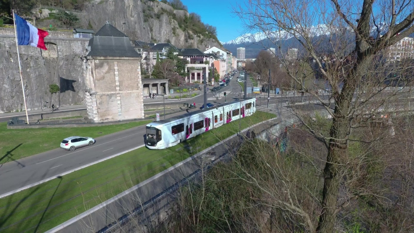 Tramway in France - Grenoble city - Aerial shot - 4K 60FPS 100MBPS Royalty-Free Stock Footage #1049049628