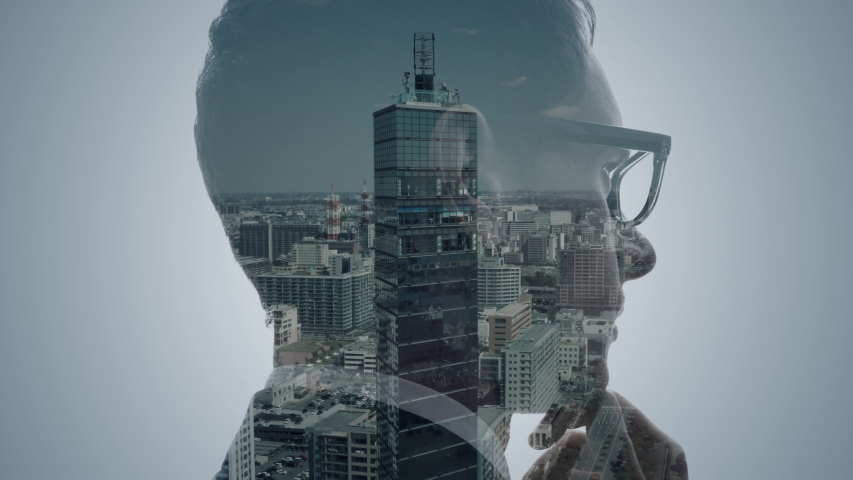 Double exposure of a businessperson and cityscape. | Shutterstock HD Video #1049061571