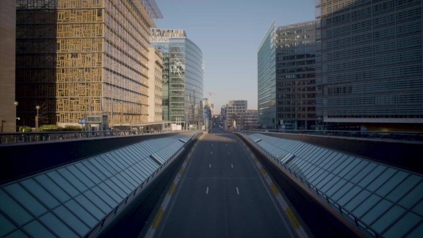 BELGIUM/BRUSSELS: smooth tilt up slow motion of the empty street in the European District due to the coronavirus. This is at the Schuman Roundabout 4K