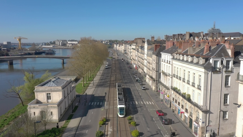 France, Nantes, tramway running in the street, drone aerial view Royalty-Free Stock Footage #1049082238