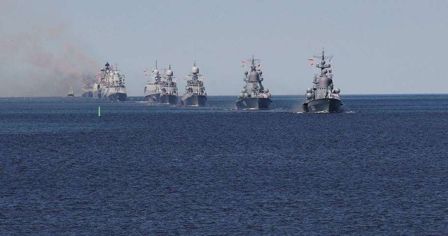A line ahead of modern russian military naval battleships warships in the row, northern fleet and baltic sea fleet, summer sunny day, 4k footage video   | Shutterstock HD Video #1049108437