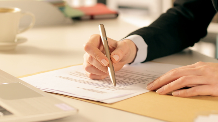 Close up of executive hands checking and signing contract on a desk at office Royalty-Free Stock Footage #1049115001