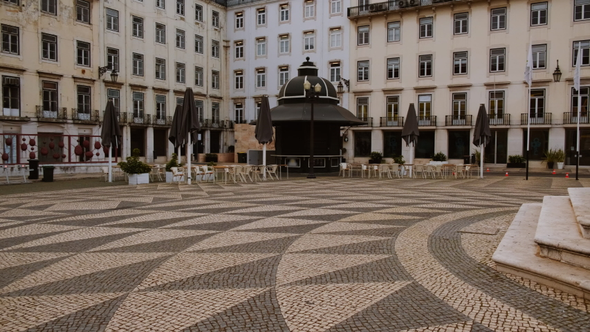 EUROPE IN LOCKDOWN - A popular square of a Mediterranean capital lies deserted, following the rise in the number of cases of CORONAVIRUS / COVID-19 infections, with a dramatic impact on social life | Shutterstock HD Video #1049117203